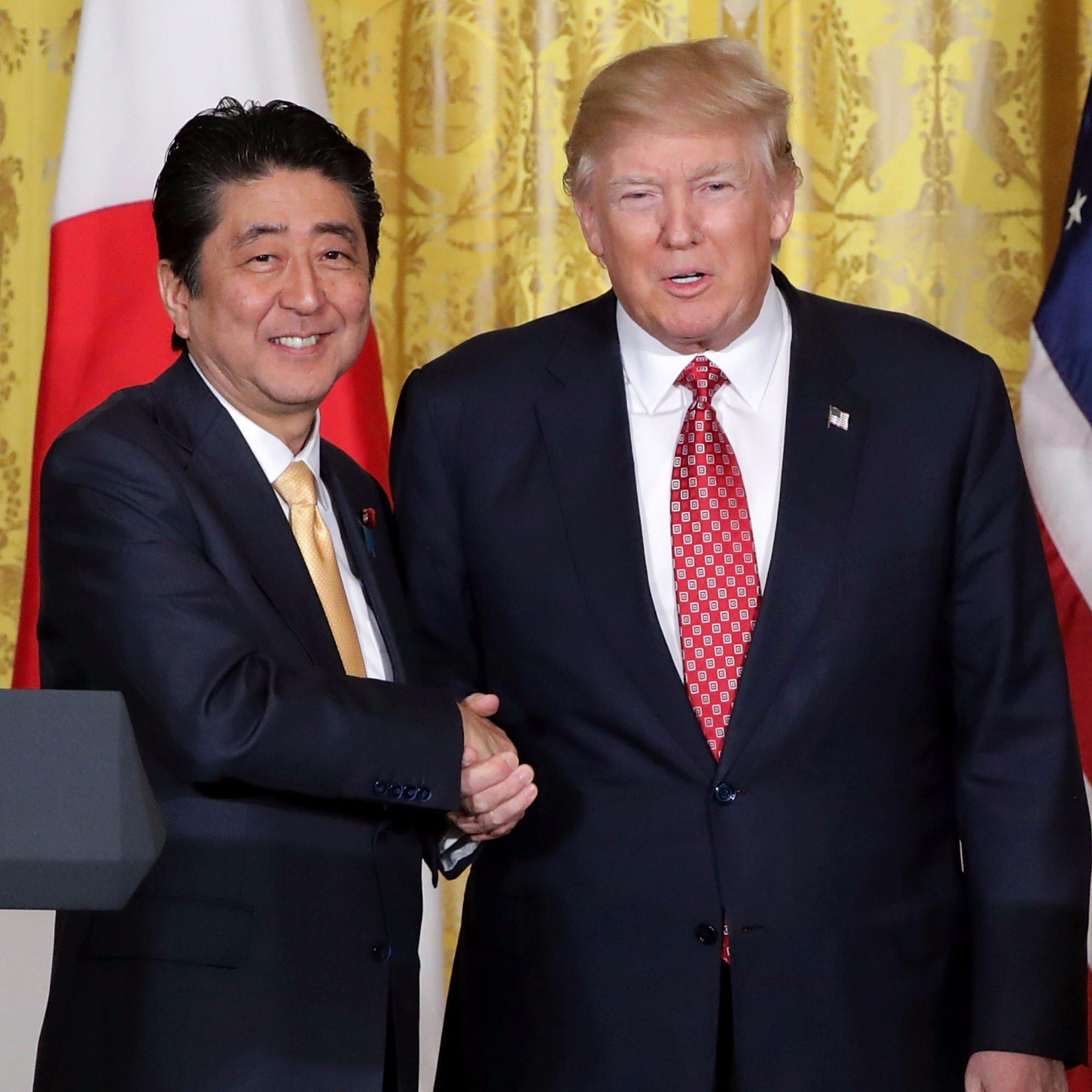 Donald-Trump-Handshake-Prime-Minister-Japan-Memes
